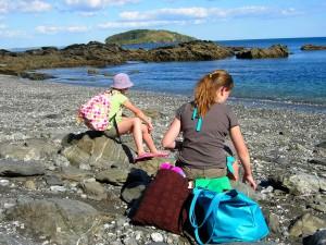 Girls on rocky shore
